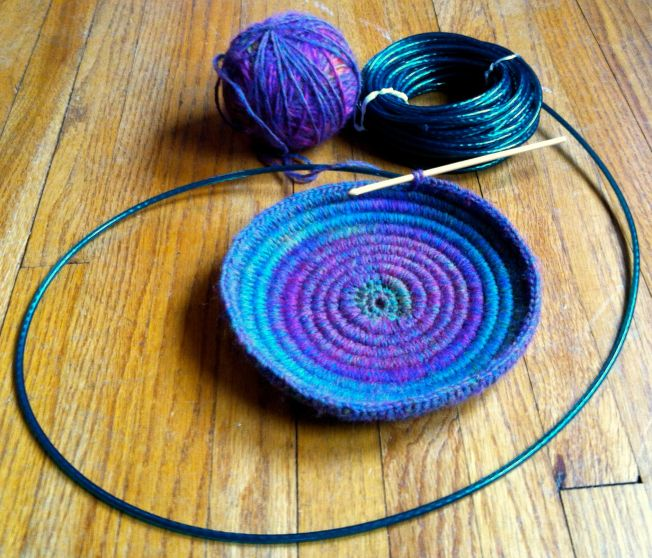 Crocheting over clothesline cord to make a basket. First to learn to crochet!