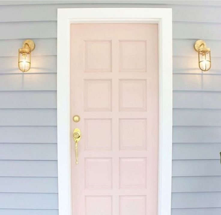 'Pink dust' coloured front door and 'stormy shower' exterior  Pink front door with grey weatherboard house NZ