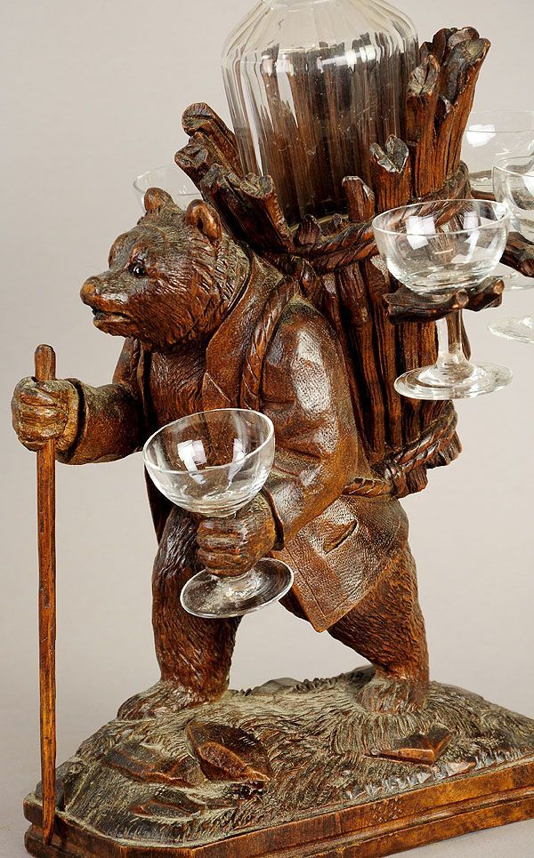wooden carved bear with walking cane and basket as liqueur stand