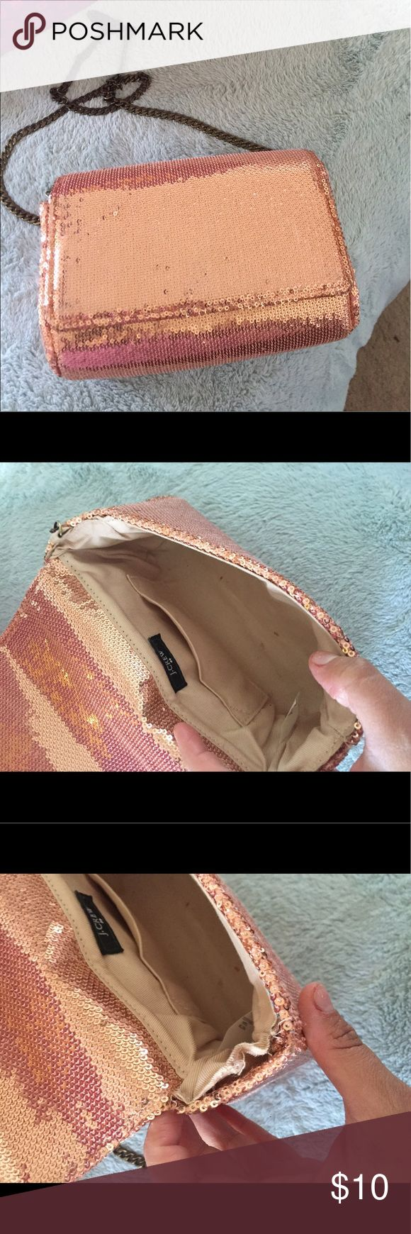 J Crew Rose Gold Sequin Clutch Beautiful rose gold sequined clutch. Has some wear and stitching opening up, chain strap is broken on one side but can be easily repaired. J Crew Bags Clutches & Wristlets