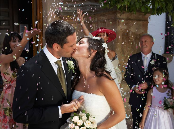 A Photographer's  Secrets to Looking Natural in Your Wedding Photos