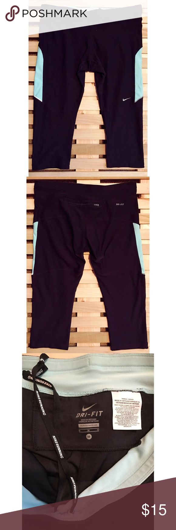 """Nike Capri Pants Awesome pair of black and light blue Nike bike/running capri pants! Have inside tie and zipper pocket on back. Size medium, tight fit. 24.5"""" long, 17.5"""" inseam. In great condition! Nike Pants"""