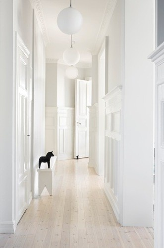 Shabby Chic Neat and Clean look. Love the white with the texture of the crown molding and the light hard wood floors.