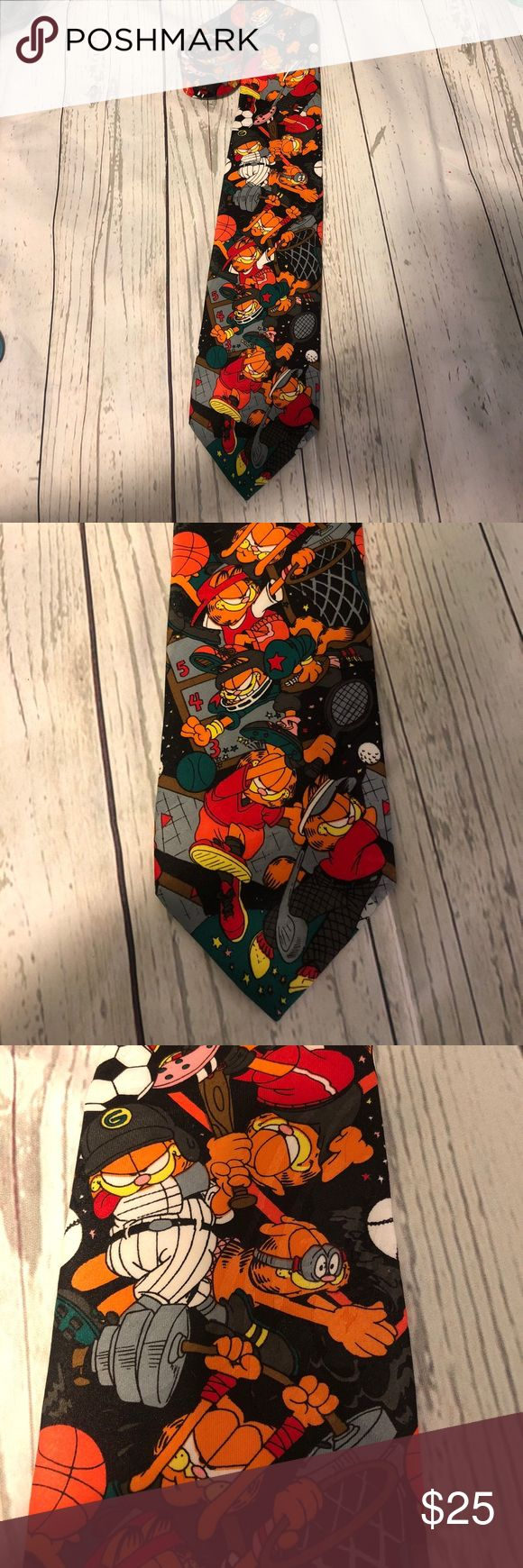 "Garfield Cartoon Sports Neck Tie Football Basket Garfield Cartoon Sports Neck Tie Football Basket  Great condition  Measures 57 ""  1112 2 30 Hot cakes Accessories Ties"