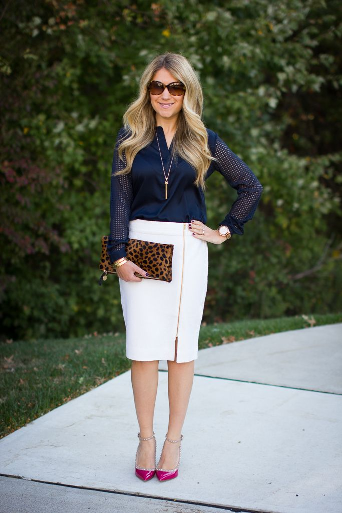 A zipper pencil skirt is paired with a navy perforated blouse for a sleek yet edgy work look.  This site has so many great outfits for work, click through to check it out!
