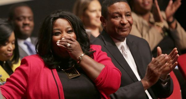 Cass Techl High School principal Lisa Phillips, center looks at the audience after realizing that she was named Michigan Association of Secondary School Principal's Principal of the Year at Cass Tech High School in Detroit on Wednesday, March 29, 2017.