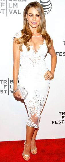 Sofia Vergara shows off her curves in a fitted white lace dress by Zuhair Murad at the Chef premiere during the Tribeca Film Festival