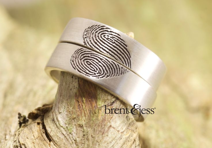 Custom handcrafted where your fingerprints when rings placed together create a heart! When separate it is just your loved ones fingerprint.