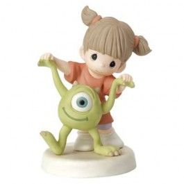 "Taking a walk, hand-in-hand with her not-so-scary friend, Mike Wazowski from Monsters Inc., a tiny tot already knows how special their friendship is. And even with one eye, Mike can see it, too! As they spend playtime together, they are sure to say, ""Eye love you,"" every step of the way. Bisque porcelain. 5 1/4"" H.   © Disney/Pixar"