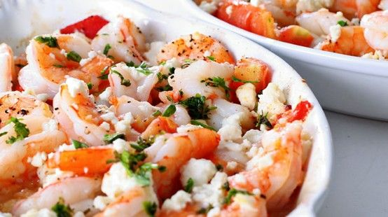 Feta and Tomato Shrimp  2 cloves garlic, minced 1 teaspoon olive oil 2 cups cherry or grape tomatoes, halved 1/4 teaspoon dried oregano leaves 1/4 teaspoon salt 1/4 teaspoon pepper 6 ounces frozen, peeled and deveined, medium shrimp, thawed 2 tablespoons sliced green onions 2 tablespoons feta cheese crumbles, reduced fat