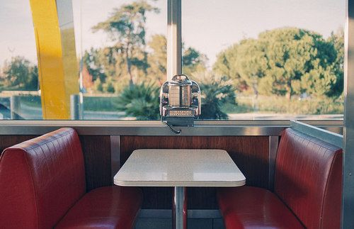 The diner looked different from a booth. The counter looked cleaner and the waitresses seemed to appear out of nowhere with your food. And outside cars passed by, fleeting across the idelic view of mountains.