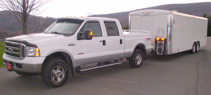 Ford pick-up truck with Haulmark Trailer and HTS Systems' patented HTS-30D Ultra-Rack. Safe fleet solutions that protect and grow your company's bottom-line!