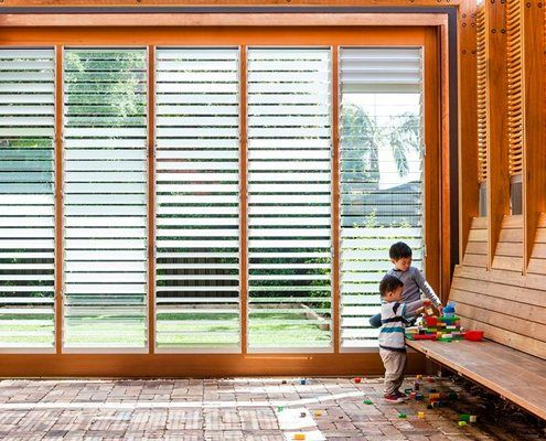 Timber framed louvre windows with a combination of clear and frosted glass make this flexible outdoor space exceptional.