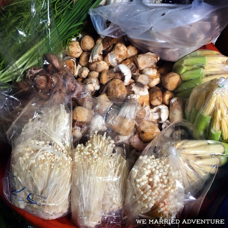 On our girls' trip to Thailand, we took a class from Bangkok's Maliwan Thai Cooking School. Our instructor took us by tuk tuk to the local Klong Toey Fresh Market to purchase ingredients, including peppers, eggplant, spices, lemongrass, dried shrimp, rice noodles, chicken, eggs, coconut sugar, garlic, mushrooms, shallots, limes, and more. Read more about it on the We Married Adventure blog!