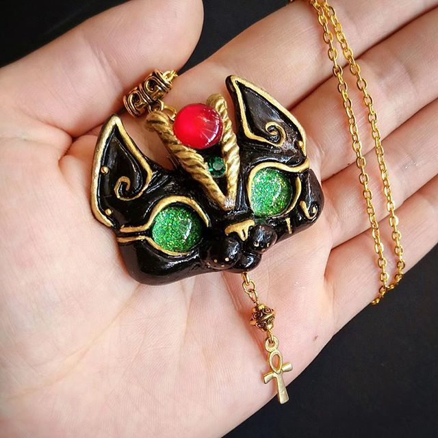Furrday Etsyupdate   three newest exclusive necklaces are available right meow, here is a Sphinx Egyptian Style Bastet Kitty necklace, with green sparkling eyes and golden crown and Egyptian cross charm ✨ #sphinxcat #sphinxlove #bastetcat #egyptianstyle #egyptiancat #catnecklace #catpendant #catcharm #cats #lovecats #catgifts #catrelatedstuff #blackcats #greeneyecat #polymerclaycharms #polymerclayjewelry #handmade #handmadejewelry #handmadependant #dolls #dollartist #lovedolls #ooakartdoll…