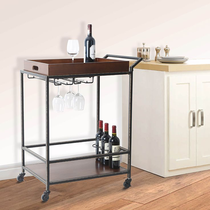Add a classy touch to your living room, dining room or other entertainment area this holiday season with this two-tier antique finish wood tube bar cart!  #TidyLiving #BarCart #Holidays #Entertaining #DinnerParties #HomeOrganization #Kitchen #Wine #Lifestyle #Home