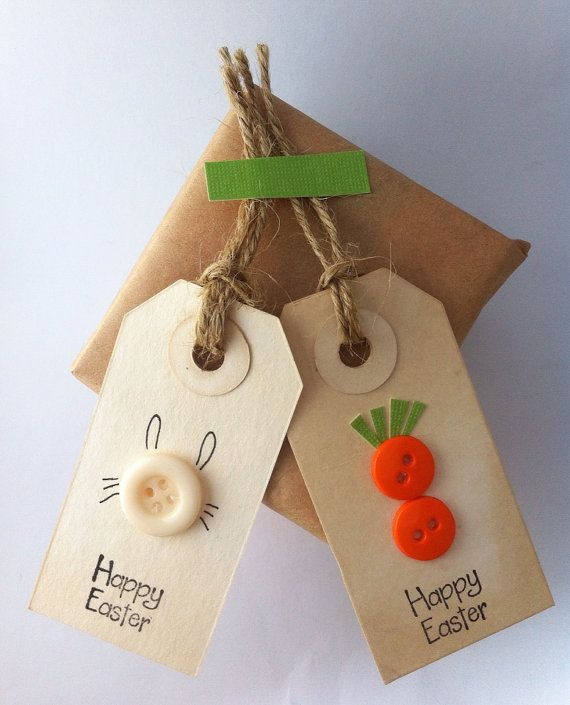 Happy Easter tags- bunnies & carrots - greeting gift tag -party favor tags (set of 6// 3 of each) Happy Easter tags are designed with a bunny rabbit and a carrot motif. These are perfect to embellish your favors and gift bags for everyone. Following is the detailed description of the tag:    Come in a set of 6  Measures: 2.65 x 1.375 (xsmall) acid free tag Hand dyed in organic black tea  Handstamped with acid- free ink Embellished with buttons Tags are stamped happy Easter on the back Tags…