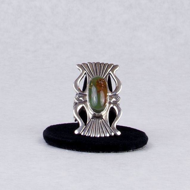 Navajo ring with Royston turquoise by artist Terry Martinez. $365. Item #480305. Size 6 1/2. Email: info@hubbelltradingpost.org  About the Artist: Terry Martinez grew up in Prewitt, NM and now lives in Greasewood, AZ with his wife and children. Terry does the old style Navajo silver work, taking pride in his pieces which sets his work apart from others.