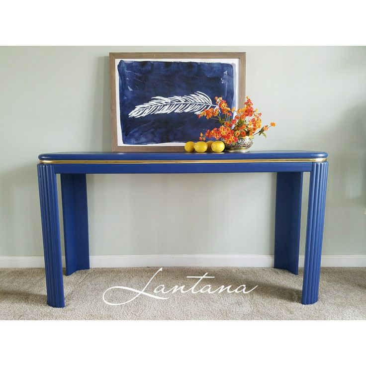 A pop of midnight blue on a vintage sofa table.  It's updated and super stylish.  #sofatable #terrabellaAcrylic-chalk paint #paintedfurniture #navyfurniture #bluefurniture #vintage #refinishe #contempoary