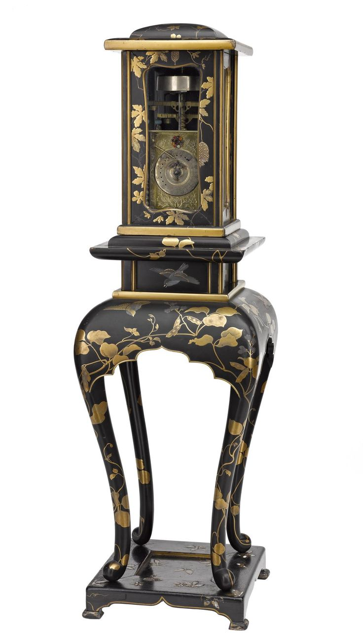 Lantern clock with silver dial and engraved side plates, corner pillars inset with coloured gemstones, maker unknown, within black and gold lacquered case and stand decorated with leaves and birds: Japan, mid 19th century