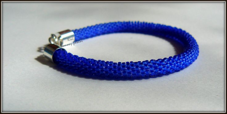 Bracelet from Toho 15/0. Little, dark blue More jelewry here: https://www.facebook.com/pages/Domowy-folklor/524316920939617?fref=ts enjoy!