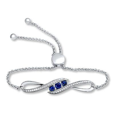"A stunning bolo bracelet with three lab-created sapphires makes for an effortlessly beautiful ""something blue."""