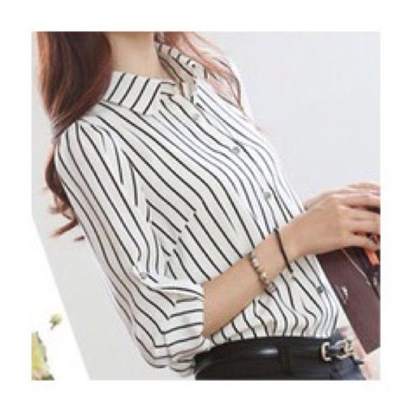 Vertical Striped Shirt White and black vertical striped shirt. Has a little stain that can't be seen when buttoned. Tops Button Down Shirts