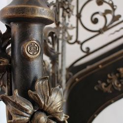 A wrought iron balustrade with a unique interior railing - detail