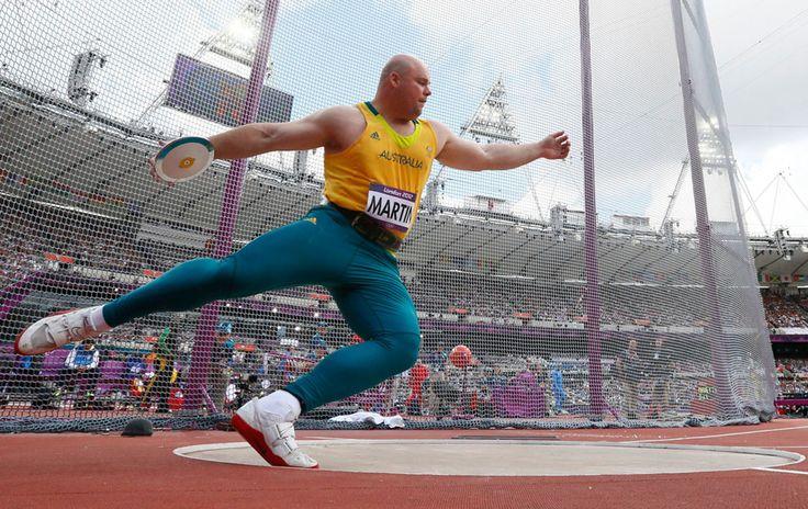 Australia's Scott Martin competes during his men's discus throw qualification at the Olympic Stadium