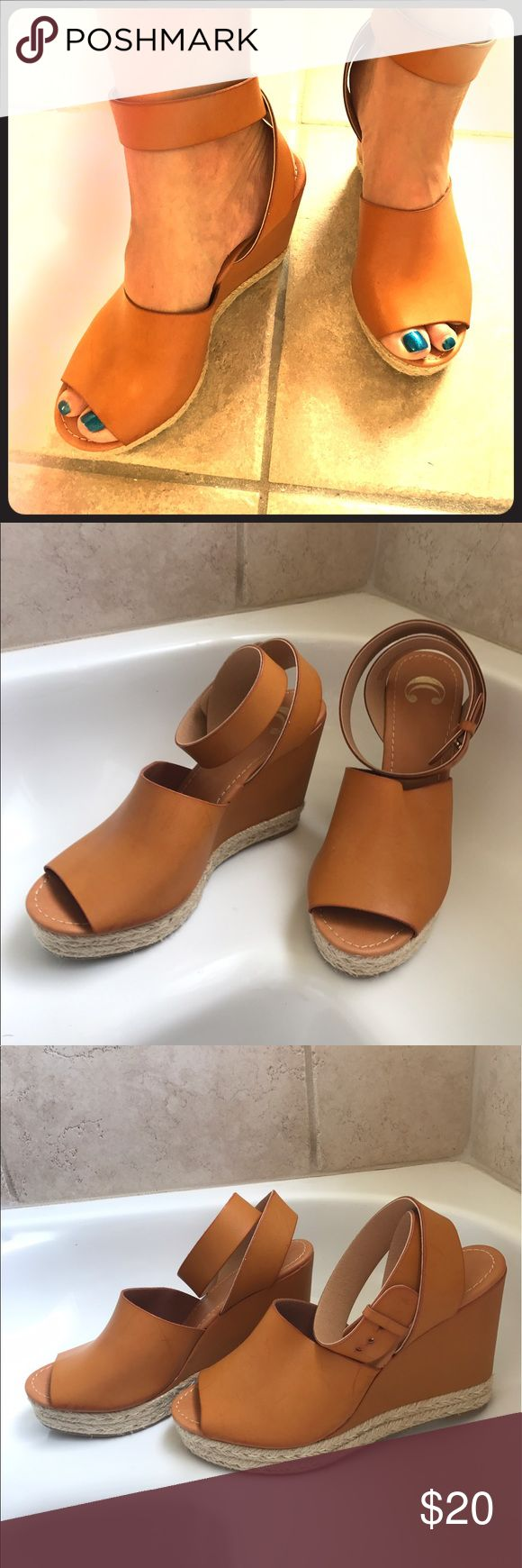 Camel wedges Camel peep toe sandals/wedges. Approx 4in heels. Wrap around ankle strap with gold button type closure. Charming Charlie Shoes Wedges