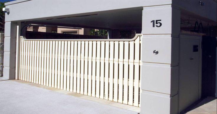 Best 25 sectional garage doors ideas on pinterest for Carport fence ideas