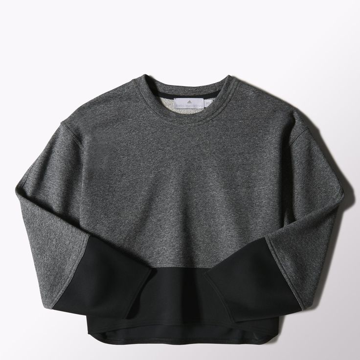 Celebrating a decade of sport and fashion, the adidas by Stella McCartney 10-Year Sweater features a subtle