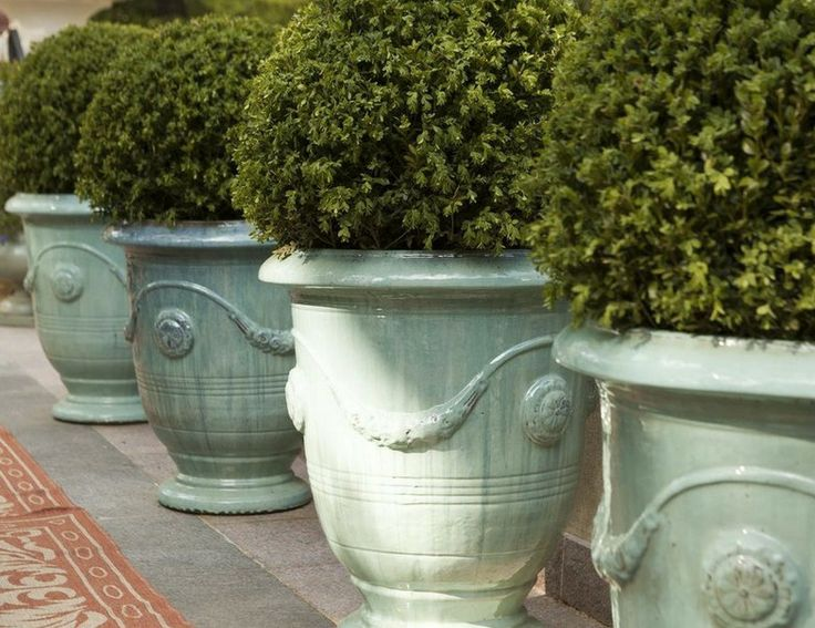 ur gorgeous ceramic Classic Anduze Planters faithfully recreate the regal look of the 16th Century French originals, complete with authentic swag and medallion details.