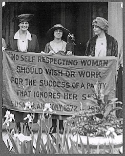 """Mrs. James Rector, Mary Dubrow, Alice Paul (members of the National Woman's Party) picket the Republican Convention of 1920 for its refusal to support the Susan B. Anthony Amendment. The women's protest sign displays a quotation from Susan B. Anthony: """"No self-respecting woman should wish or work for a party that ignores her sex""""."""