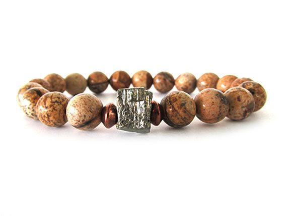 """How cool is this men's bracelet with 10mm picture jasper beads and a rough golden pyrite nugget. The colors and veining in the jasper beads are quite intriguing making each bracelet truly unique. The iron pyrite nugget """"dice"""" bead is in its natural state. ... rough and unpolished crystalline cubed nuggets."""