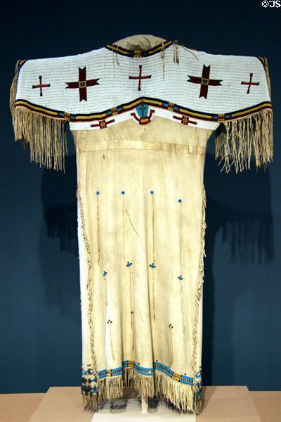 Lakota Sioux deerskin dress with beadwork  feather decoration (c1880) at Denver Art Museum. Denver, CO.
