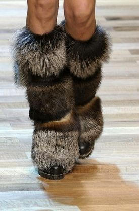 Gotta love the fur snow boots! Like these boots, Helmet Huggers are all about the fur as well. We are faux,  visit us at http://www.helmethuggers.com/shop/ for our bright spandex shells with faux fur trim to cover your helmet.