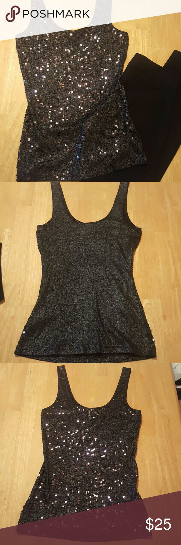 Express black sequence tang top Express your self with this cute tang top by express. All sequence in great condition and comfortable to wear. Dress it up with a cute skirt or leggings. Only worn once. Fits small to medium. Express Tops Tank Tops