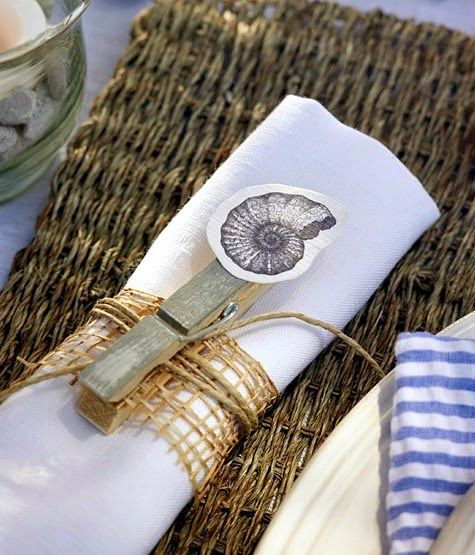 Clever DIY napkin ring with clothes pin: http://www.completely-coastal.com/2015/06/coastal-summer-table-decor-idea.html