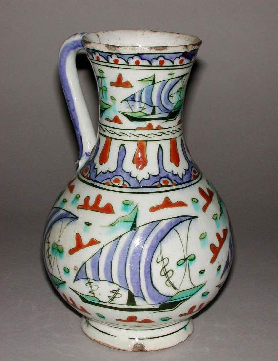 Maker: Unknown; potter Category: fritware (stonepaste) Name(s): jug Islamic pottery; category Iznik; category Date: circa 1570 — circa 1590 School/Style: Ottoman Period: late 16th Century