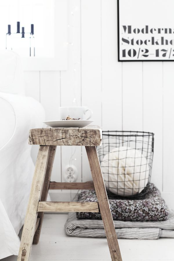 Rustic yet contemporary at the same time. A simple nightstand for a guest space, accompanying basket for linens.