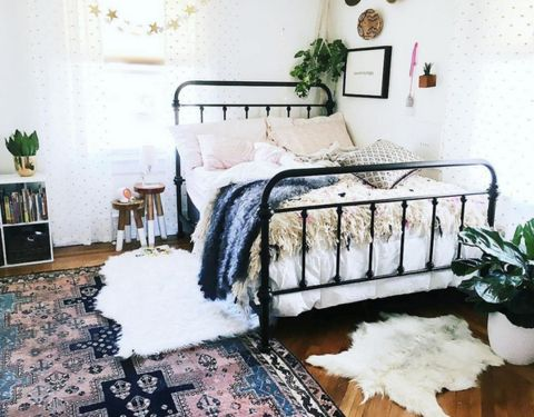 """East Perry's Large """"LuBlu"""" Throw, Knitted Gotland Throw sitting pretty in this beautiful modern bohemian bedroom. Perfect for your modern home interior, boho home and decor, or nursery decor. Check the link for full product info."""