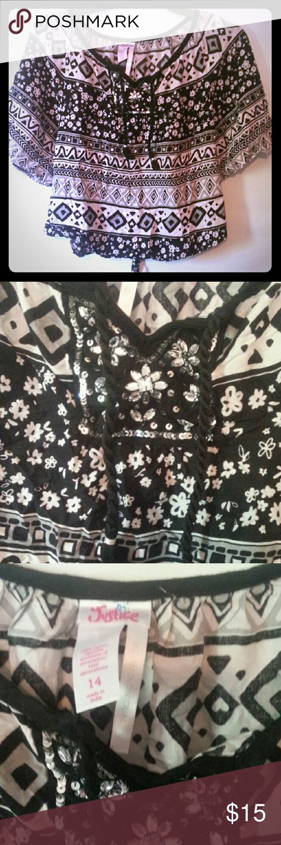 Justice shirt Black and white jeweled shirt . Bought at justice .  Worn very little ties in back.no stains or holes Justice   Shirts & Tops