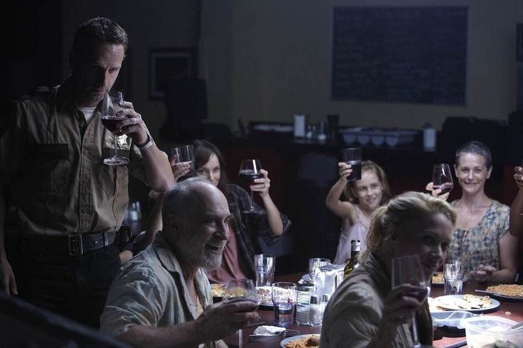 Later, the group feasts in the CDC cafeteria, joyfully drinking wine and liquor from the fully stocked fridge. They are beyond happy about finding a safe place to stay and a good meal. Glenn is drunk, much to Daryl's satisfaction.