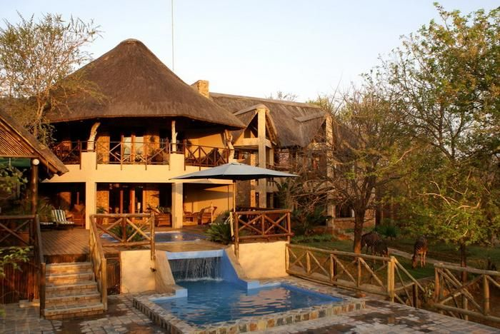 Crocodile Kruger Safari Lodge, Marloth Park. Not only will you have a stylish stay, you'll also have a visit by friendly wildlife.