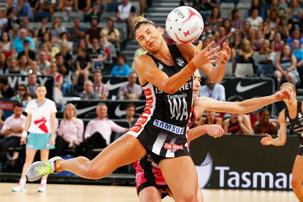 Madi Robinson of the Magpies receives a pass during the round four Super Netball match between the Magpies and the Thunderbirds at Hisense Arena on March 12, 2017 in Melbourne, Australia.