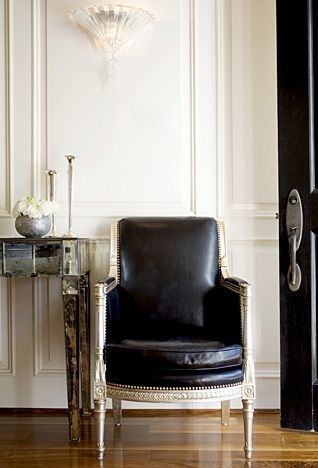 black leather chair with distressed cream frame via Windsor Smith