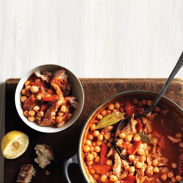 A couple of chicken thighs         amount to a lot of flavor alongside the filling         chickpeas and crusty bread in this hearty         Lebanese-inspired stew.