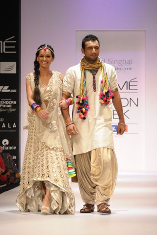 Menswear Cream Long-Short Kurta with Gold Dhoti and PS Signature Dori Stole. SHOP THE LOOK AT http://www.payalsinghal.com/off-the-runway/ps-signature-dori-mens-kurta