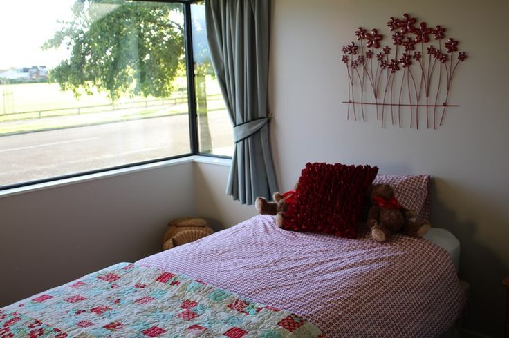"""We love Issys room ..'This is my daughter Issys room.  She is actually blind but we chose the Daisy as we loved the strong colour of """"Daisy"""" that she wont grow out of.  We also loved the quality of the linen as it has a nice feel for her."""""""